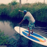 ready to paddle board on red paddle co sup